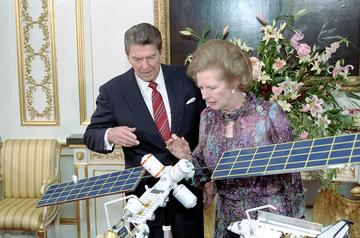 president ronald reagan and margaret thatcher viewing model of manned space station at lancaster house in london